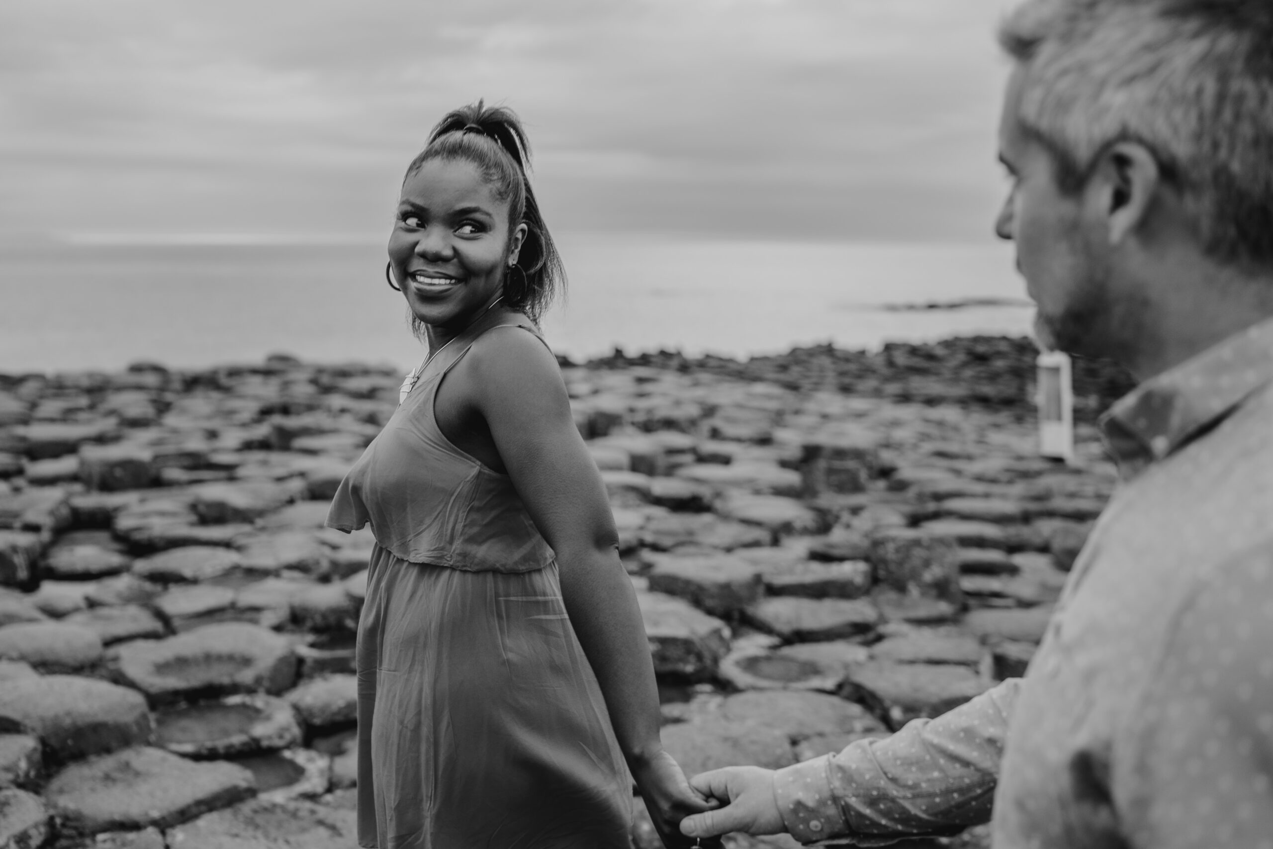 black and white photo, giants causeway, interracial couple